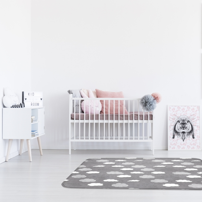 Animal drawings gallery in girl's bedroom with pink pillows on bed and white cupboard